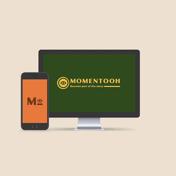 Brand Identity mockup of logo design on a desktop screen and submark design on a mobile screen for our client Momentooh.